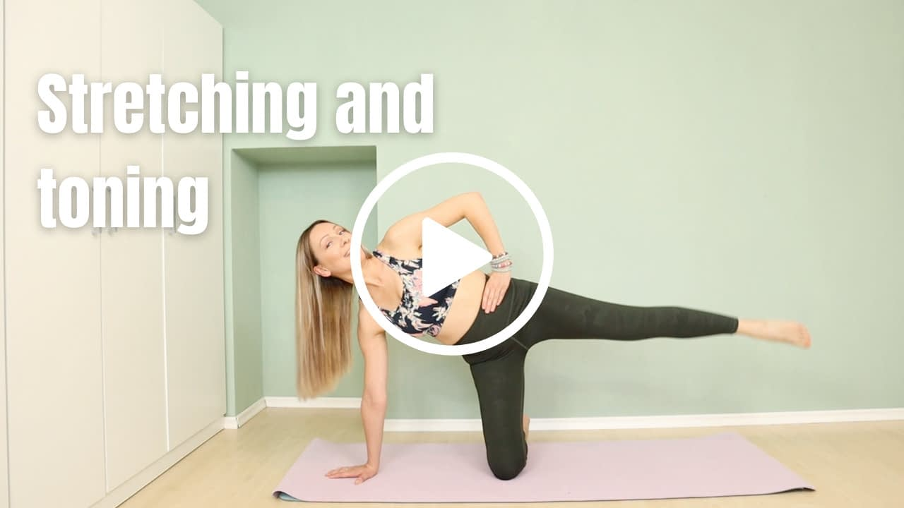 Pilates Instructor in side kneeling plank position with one leg reaching