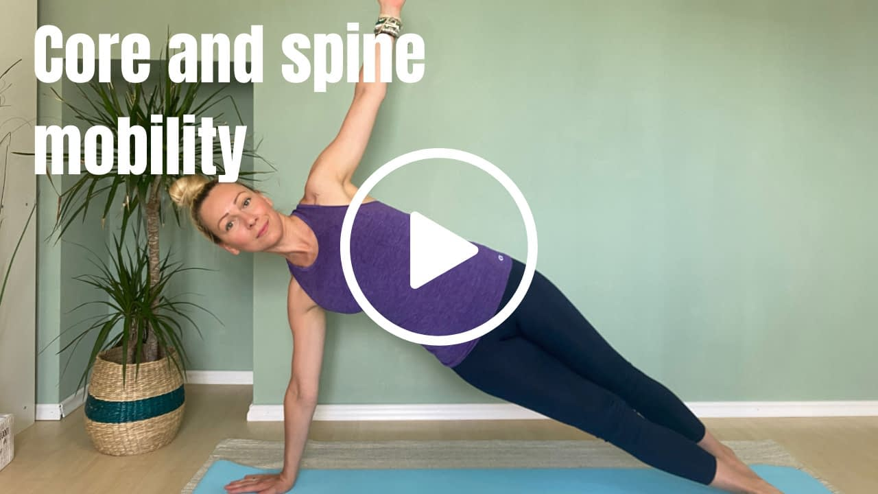 Pilates instructor in side plank position