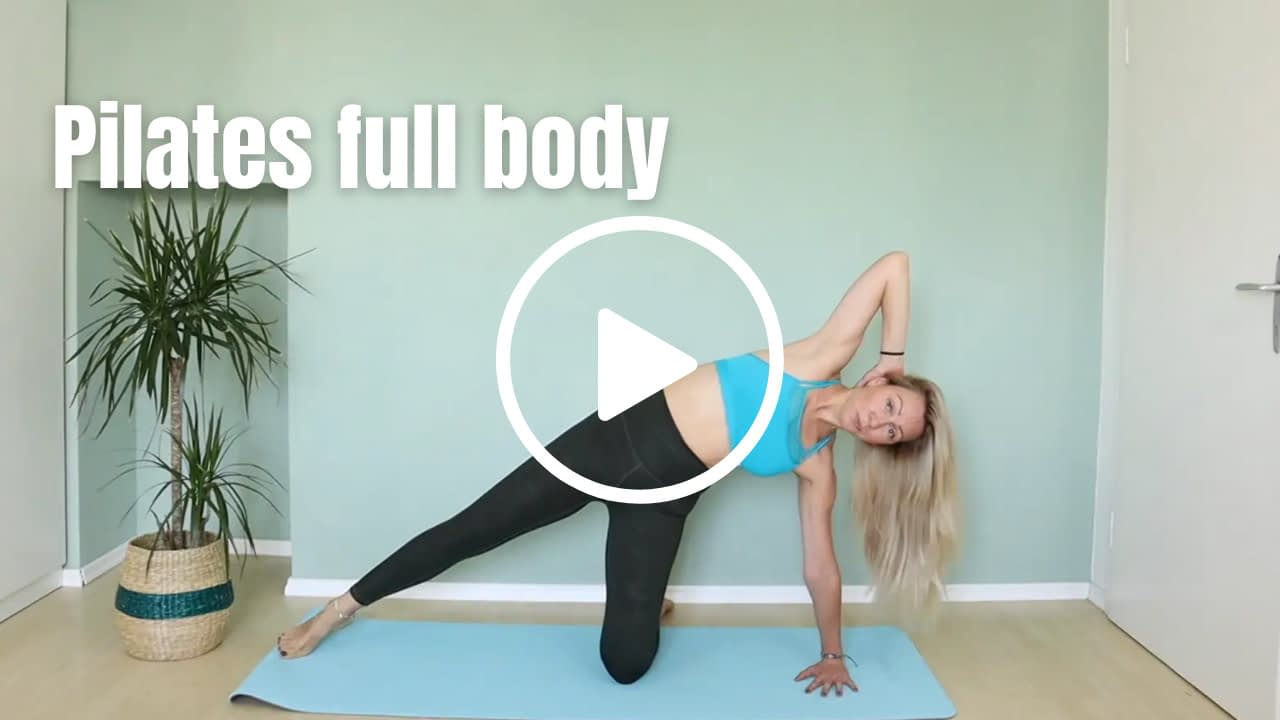 Pilates Instructor in side kneeling position with one hand behind head