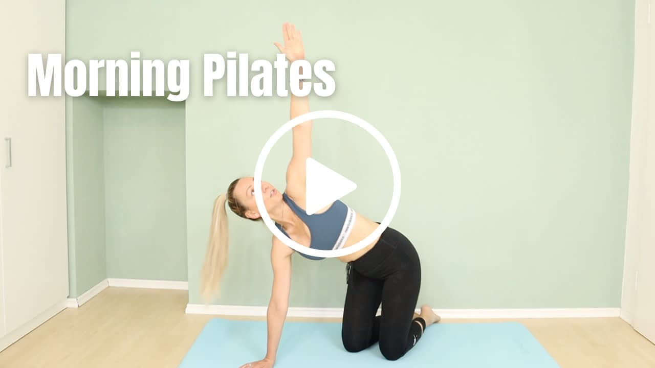 Pilates Instructor in thread a needle pose